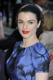 The actress wore a messy, tousled bun with vibrant red lipstick and glamorous black lashes.