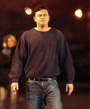 Leonardo DiCaprio looked rugged in a baggy black crewneck sweater and jeans while filming 'Wolf of Wall Street.'