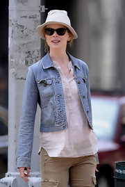 Nicole tosses on a hat to wear with her casual ensemble while out with husband Keith Urban.