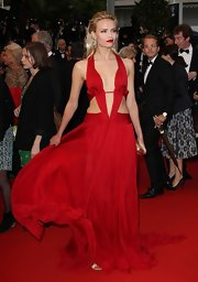 Natasha looked like a superhero in this red silk cutout dress at the Cannes Film Festival.