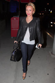 Hayden's collarless leather jacket was worn with skinny jeans and bold red lips.