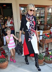 Heidi Klum played with prints in a color-blocked dress and southwestern inspired scarf while out to lunch.