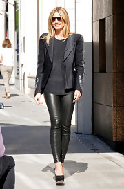 Heidi Klum loves slim fitting pieces like these skinny leather pants.