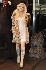"Heidi wore a lovely white ""Burnout Patterned Cable Tunic"" under a gold textured coat."