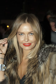 Lara Bingle gave her bronzed look with vivid red lipstick.