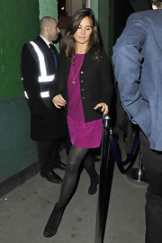 Pippa Middleton wore a long gold pendant necklace.