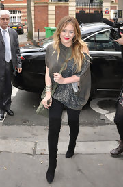 Hilary Duff arrived at a radio station in Paris wearing black suede over-the-knee boots.