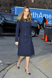 Hilary Swank is known for her classic style just this classic navy wool coat, which she donned for New York Fashion Week.