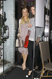 Paris Hilton gave her look an exotic touch with a python print Lady Dior tote.