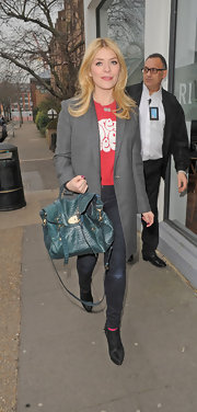 An oversized gray blazer gave Holly Willoughby's street style a bit of a cool masculine touch.