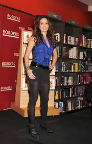 Brooke Burke toughened up her look with buckled black leather platform boots.