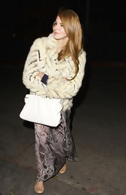 Lana Del Rey glammed up a bohemian maxi dress with a quilted fur coat.