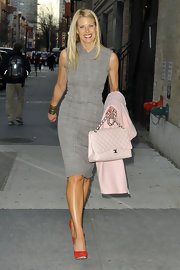 Beth Stern added polish to her ladylike sheath with a blush quilted flap bag.