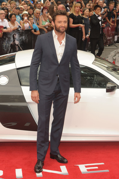 Hugh kept it simple and chic with a deep charcoal, two-button suit.