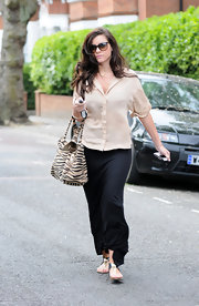 Imogen wore her long dark waves down while out in London.