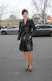 Delphine Chaneac looked chic wearing a leather coat at the Versace Spring/Summer 2012 show.