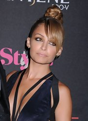 Check out Nicole Richie's intricately braided top knot and side-swept bangs!