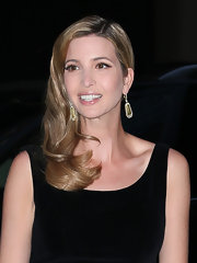 Ivanka Trump swept her golden waves to one side for and old-school glamorous look.