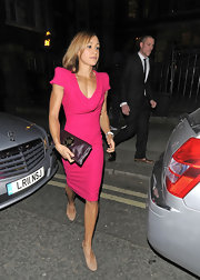 Jessica Ennis attended the H&M party in London wearing a girly hot-pink cowl-neck dress.