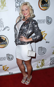 Jacque Lyne sparkled on the red carpet when she donned a silver sequined jacket.
