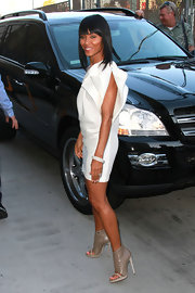 Jada looked fabulous in a structured mini dress with quilted leather booties.