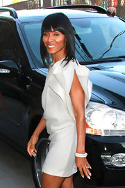 Jada paired her flowing white dress with a few sparkling bangle bracelets.