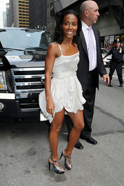 Jada showed off her svelte stems in a fabulous white mini dress and metallic t-strap platform sandals.