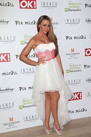 Michelle Heaton looked stunning in a white dress with a high-low hem at the Pia Michi Charity Ball.