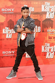 Jade paired his dark skinny jeans with gray suede high-top sneakers.