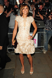 Jessica Ennis complemented her frilly dress with simple nude peep-toes.