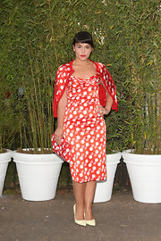 Jessie Ware sported a retro-inspired polka dot dress with a matching cardigan and purse at the Serpentine Gallery Summer Party.