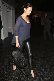 Jamie Chung arrived at the Chateau Marmont wearing a pair of strappy black heels.