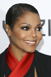 Janet Jackson is continuously changing her look. The music icon chopped off her long locks in recent months and opted for a cropped 'do. While attending the 'For Colored Girls' premiere she opted for a sleek side swept look.