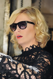 "The actress wore gold-detailed wayfarers while signing autographs outside of ""Live with Regis & Kelly""."