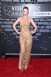 Iggy Azalea revealed some major skin at the VMAs with this gold leaf-embroidered sheer dress.