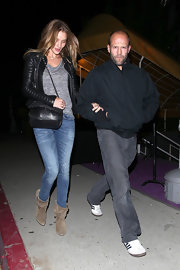 Rosie Huntington-Whiteley teamed her jacket with washed-out skinny jeans for a rugged-chic look.