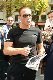 Jean-Claude Van Damme wore a black T-shirt printed with his initials while mingling with fans in Paris.
