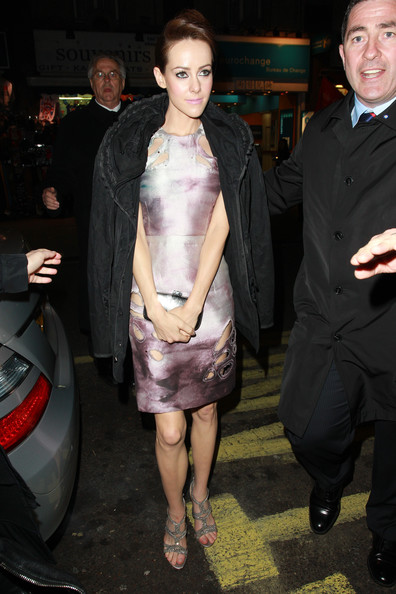Jena Malone arrived for the 'Sucker Punch' after-party wearing a black wool coat over a lilac cutout dress.