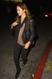 Natalie Imbruglia left the Chateau Marmont in West Hollywood wearing a sleek pair of black leather ankle boots.
