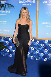 Jennifer Aniston accented her sheer black gown with a gray Burberry Custom Alligator clutch.