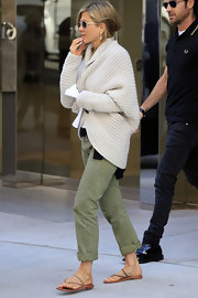 Jennifer Aniston looked casual and comfy in this cream oversized cardigan.