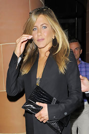 Jen added a touch of glamor to her black ensemble with classic gold hoop earrings.
