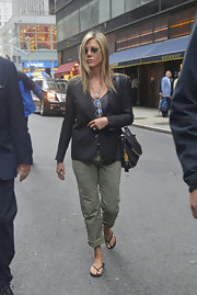 Jennifer Aniston added just a touch of casual to her look with these army green cuffed chinos.
