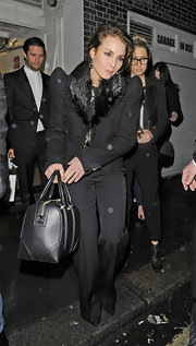 Noomi Rapace looked seriously chic at the pre-BAFTA party in a black pantsuit with a fur collar and pointy shoulders.