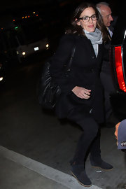 Jennifer Garner sported a basic black wool coat while traveling through LAX.