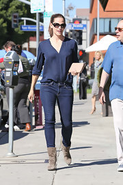 A clean placket and chic rolled sleeves were the highlights of Jennifer's lovely navy blouse.