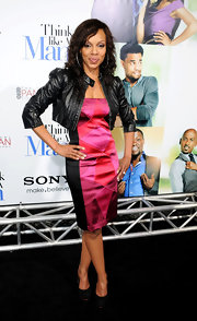 Wendy Raquel Robinson's cropped black leather jacket added a heavy dose of chic to her dress.
