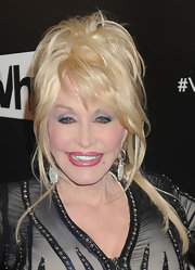 Dolly showed off her stunning diamond earrings with a messy updo.