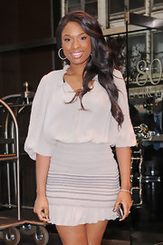 Jennifer Hudson styled her hair in soft curls while leaving her hotel in New York.