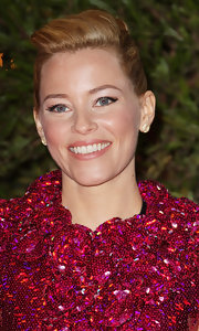 Elizabeth Banks wore a pair of GemGirls pave disc earrings at 'The Hunger Games' Paris premiere.